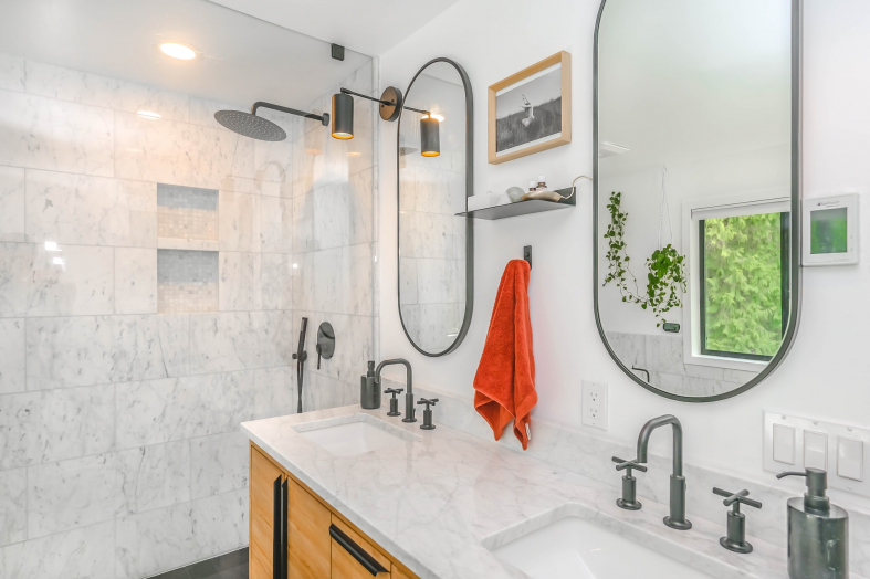 modern looking bathroom with 2 mirrors